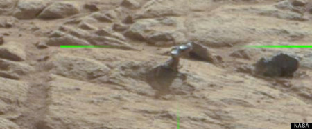 r 8441458081 9F48BAAB8B O large570 450x187 Mars Rover Spots Metallic Arm Sticking Out Of A Rock